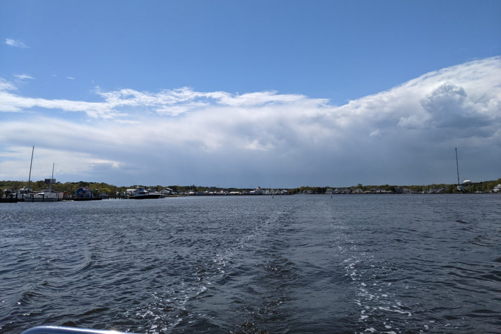 Boat Wake and Distant Clouds