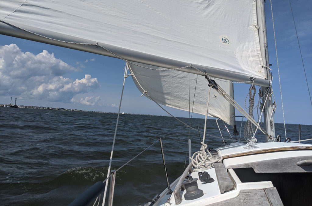 Sailing off the wind with the liftboat in the distance