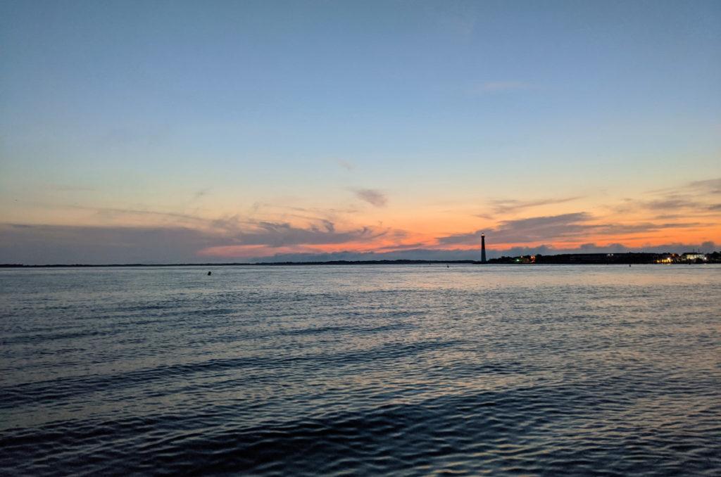 Pre-Dawn Sky as the Sun Rises Behind the Lighthouse