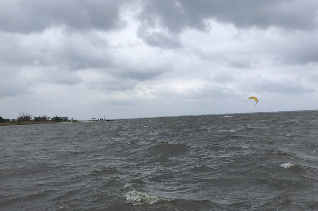 Not Great Photo of Windsurfer and Kite Boarder