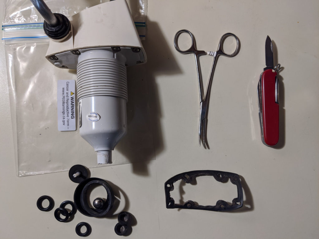Assortment of Tools and Pump Parts
