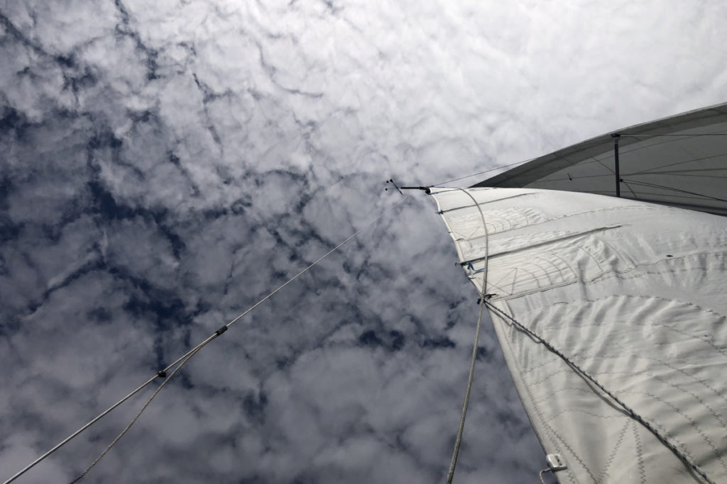 Flaky Clouds Over Boat